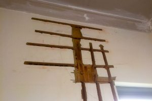structural damage to wall fixed with internal supports