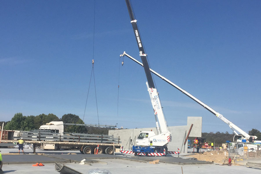 crane lifts concrete tilt panels